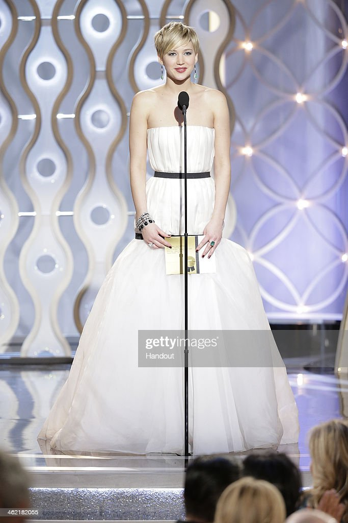 In this handout photo provided by NBCUniversal Presenter Jennifer Lawrence speaks onstage during the 71st Annual Golden Globe Award at The Beverly...