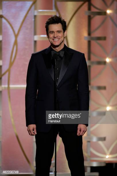 In this handout photo provided by NBCUniversal Presenter Jim Carrey speaks during the 71st Annual Golden Globe Award at The Beverly Hilton Hotel on...