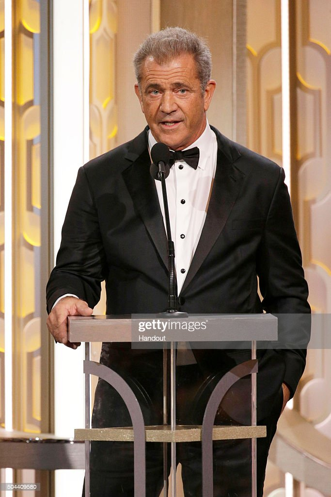 In this handout photo provided by NBCUniversal Presenter Mel Gibson speaks onstage during the 73rd Annual Golden Globe Awards at The Beverly Hilton...