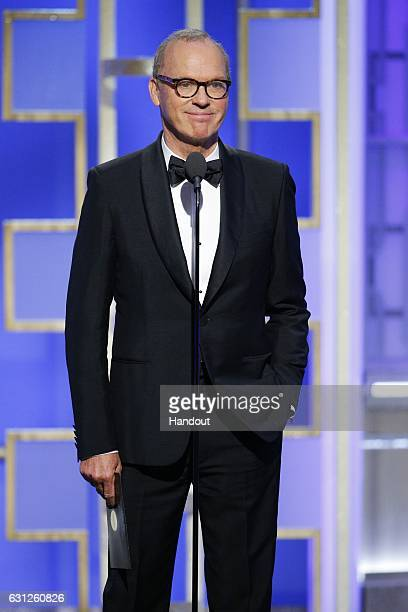 In this handout photo provided by NBCUniversal presenter Michael Keaton onstage during the 74th Annual Golden Globe Awards at The Beverly Hilton...