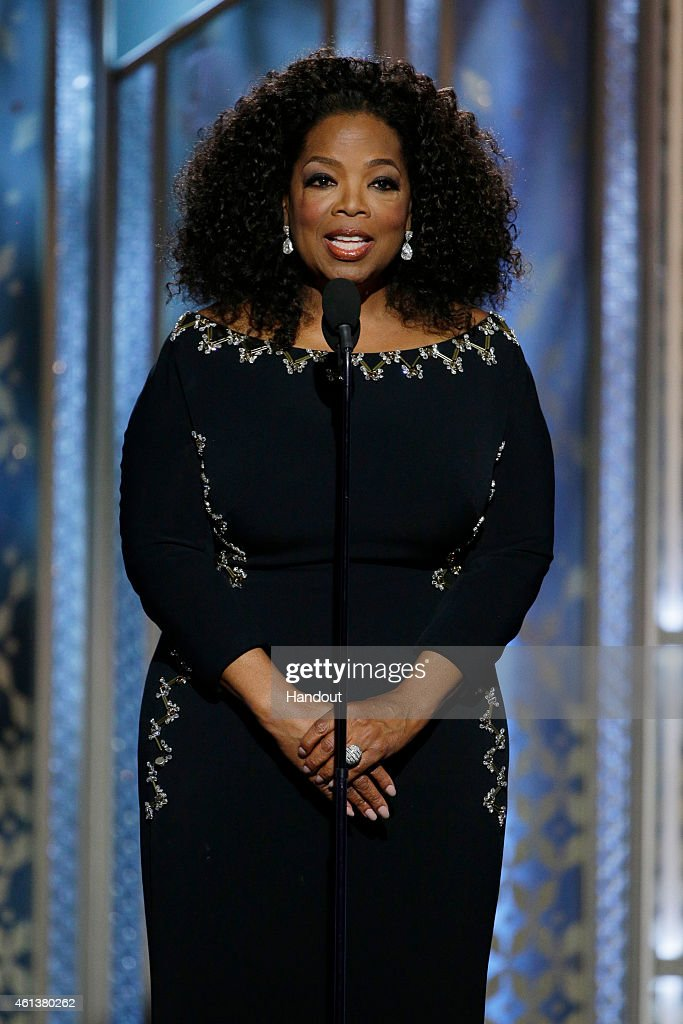 In this handout photo provided by NBCUniversal Presenter Oprah Winfrey speaks onstage during the 72nd Annual Golden Globe Awards at The Beverly...