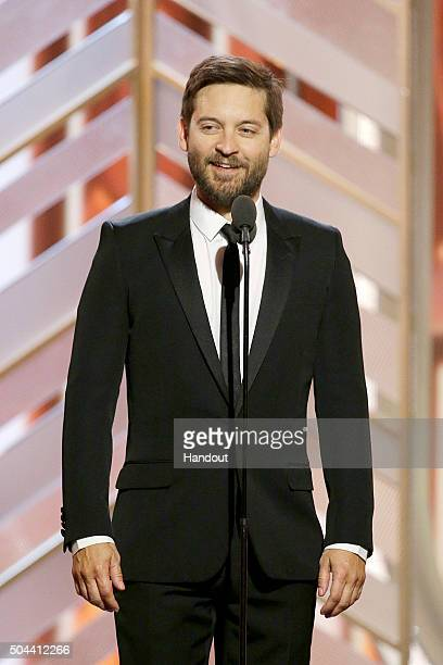 In this handout photo provided by NBCUniversal Presenter Toby Maguire speaks onstage during the 73rd Annual Golden Globe Awards at The Beverly Hilton...