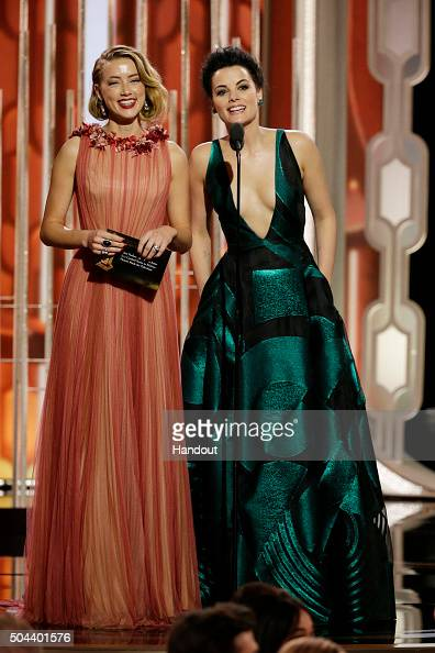 In this handout photo provided by NBCUniversal Presenters Amber Heard and Jaimie Alexander onstage during the 73rd Annual Golden Globe Awards at The...