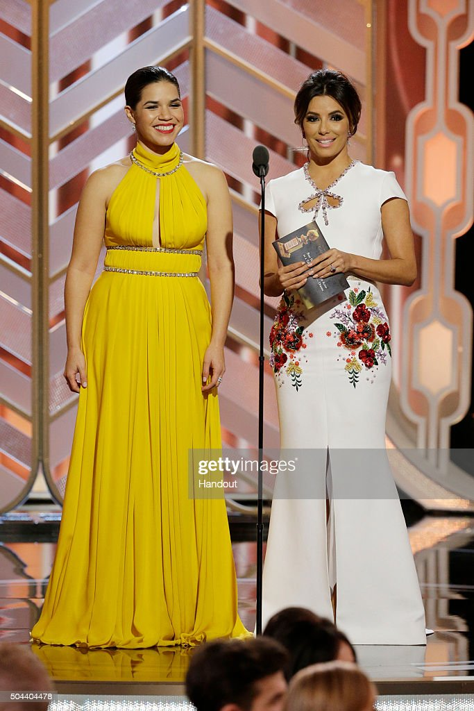 In this handout photo provided by NBCUniversal Presenters America Ferrera and Eva Longoria speak onstage during the 73rd Annual Golden Globe Awards...
