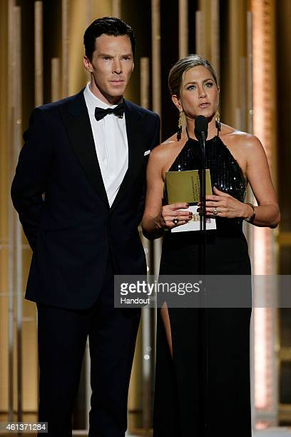 In this handout photo provided by NBCUniversal Presenters Benedict Cumberbatch and Jennifer Aniston speak onstage during the 72nd Annual Golden Globe...