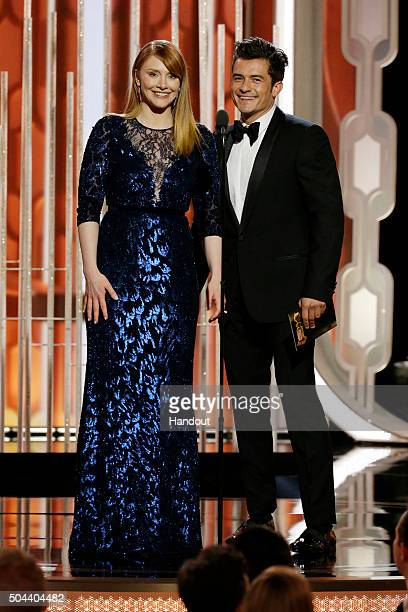 In this handout photo provided by NBCUniversal Presenters Bryce Dallas Howard and Orlando Bloom speak onstage during the 73rd Annual Golden Globe...