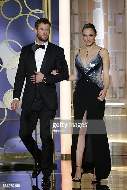 In this handout photo provided by NBCUniversal presenters Chris Hemsworth and Gal Gadot onstage during the 74th Annual Golden Globe Awards at The...