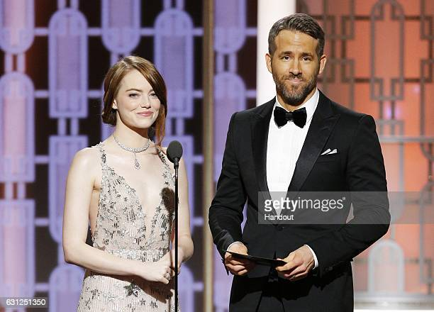In this handout photo provided by NBCUniversal presenters Emma Stone and Ryan Reynolds onstage during the 74th Annual Golden Globe Awards at The...