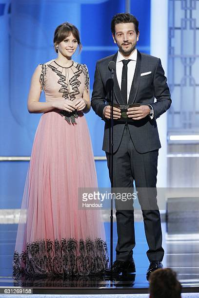 In this handout photo provided by NBCUniversal presenters Felicity Jones and Diego Luna onstage during the 74th Annual Golden Globe Awards at The...