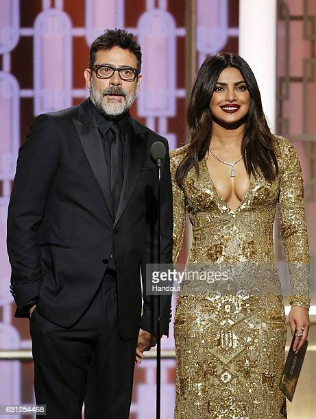In this handout photo provided by NBCUniversal presenters Jeffrey Dean Morgan and Priyanka Chopra onstage during the 74th Annual Golden Globe Awards...
