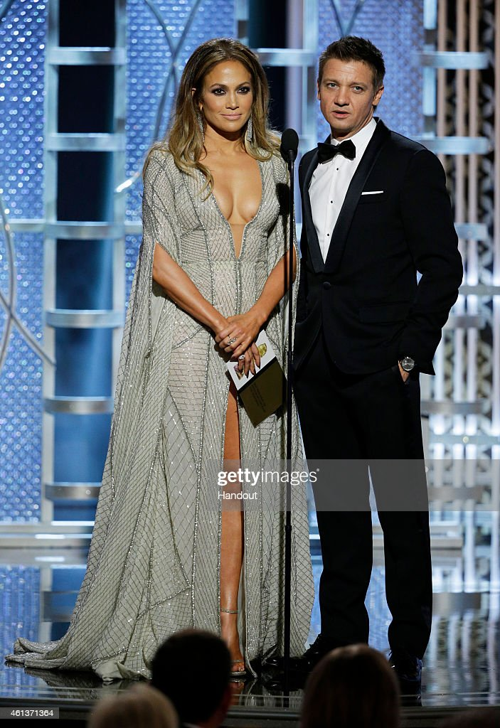 In this handout photo provided by NBCUniversal, Presenters Jennifer Lopez and <a gi-track='captionPersonalityLinkClicked' href=/galleries/search?phrase=Jeremy+Renner&family=editorial&specificpeople=708701 ng-click='$event.stopPropagation()'>Jeremy Renner</a> speaks onstage during the 72nd Annual Golden Globe Awards at The Beverly Hilton Hotel on January 11, 2015 in Beverly Hills, California.