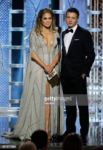 In this handout photo provided by NBCUniversal Presenters Jennifer Lopez and Jeremy Renner speaks onstage during the 72nd Annual Golden Globe Awards...