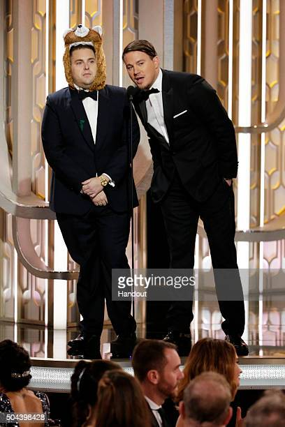 In this handout photo provided by NBCUniversal Presenters Jonah Hill and Channing Tatum onstage during the 73rd Annual Golden Globe Awards at The...