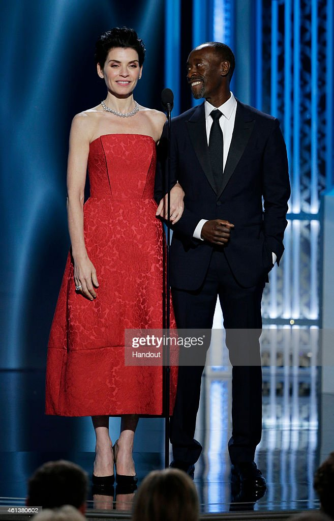 In this handout photo provided by NBCUniversal Presenters Julianna Margulies and Don Cheadle speak onstage during the 72nd Annual Golden Globe Awards...