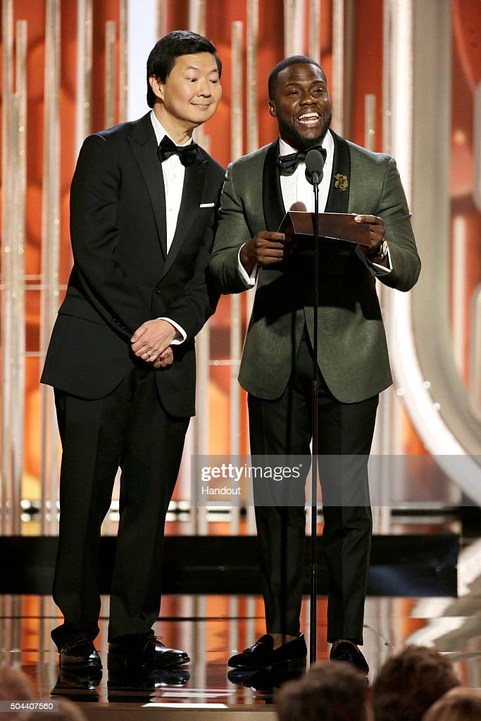 In this handout photo provided by NBCUniversal Presenters Ken Jeong and Kevin Hart speak onstage during the 73rd Annual Golden Globe Awards at The...