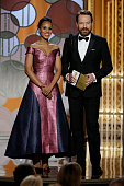In this handout photo provided by NBCUniversal Presenters Kerry Washington and Bryan Cranston speak onstage during the 72nd Annual Golden Globe...