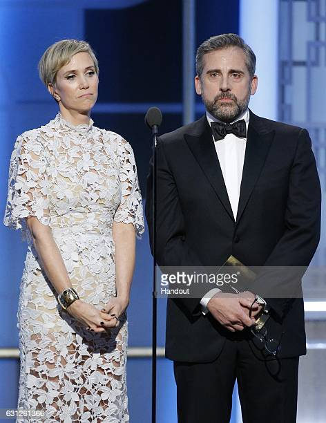 In this handout photo provided by NBCUniversal presenters Kristen Wiig and Steve Carell onstage during the 74th Annual Golden Globe Awards at The...