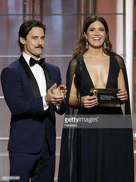 In this handout photo provided by NBCUniversal presenters Milo Ventimiglia and Mandy Moore onstage during the 74th Annual Golden Globe Awards at The...