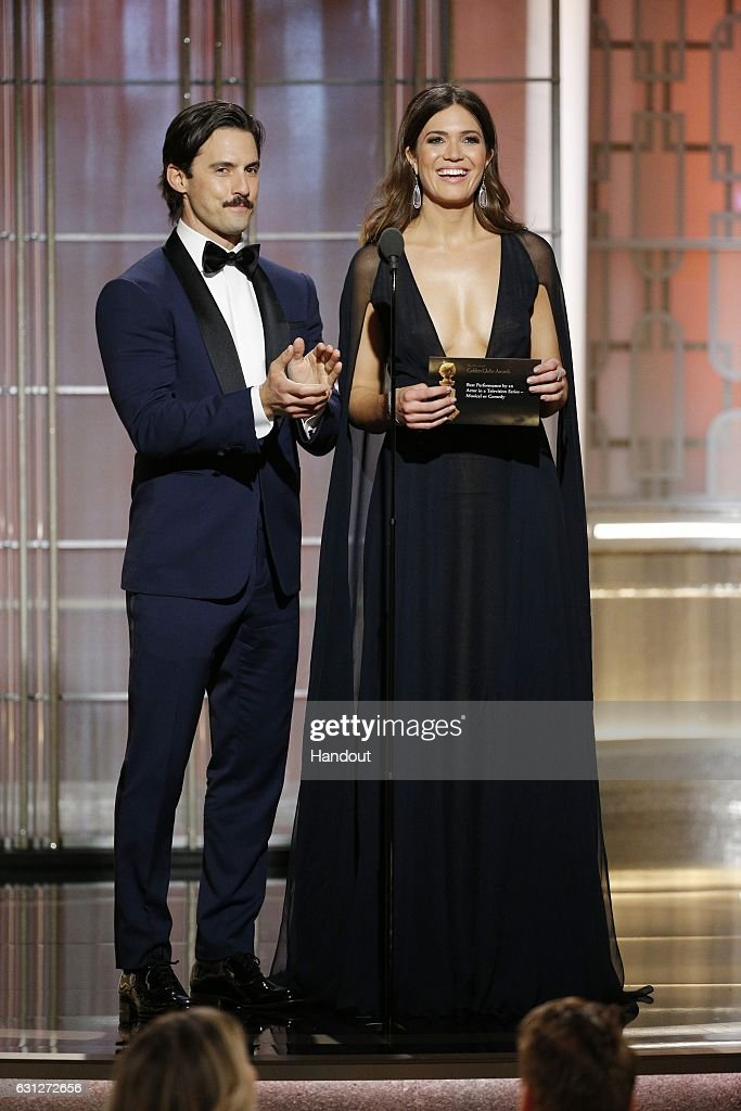 In this handout photo provided by NBCUniversal, presenters Milo Ventimiglia (L) and Mandy Moore onstage during the 74th Annual Golden Globe Awards at The Beverly Hilton Hotel on January 8, 2017 in Beverly Hills, California.