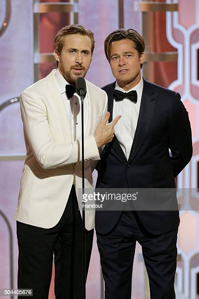 In this handout photo provided by NBCUniversal Presenters Ryan Gosling and Brad Pitt speak onstage during the 73rd Annual Golden Globe Awards at The...