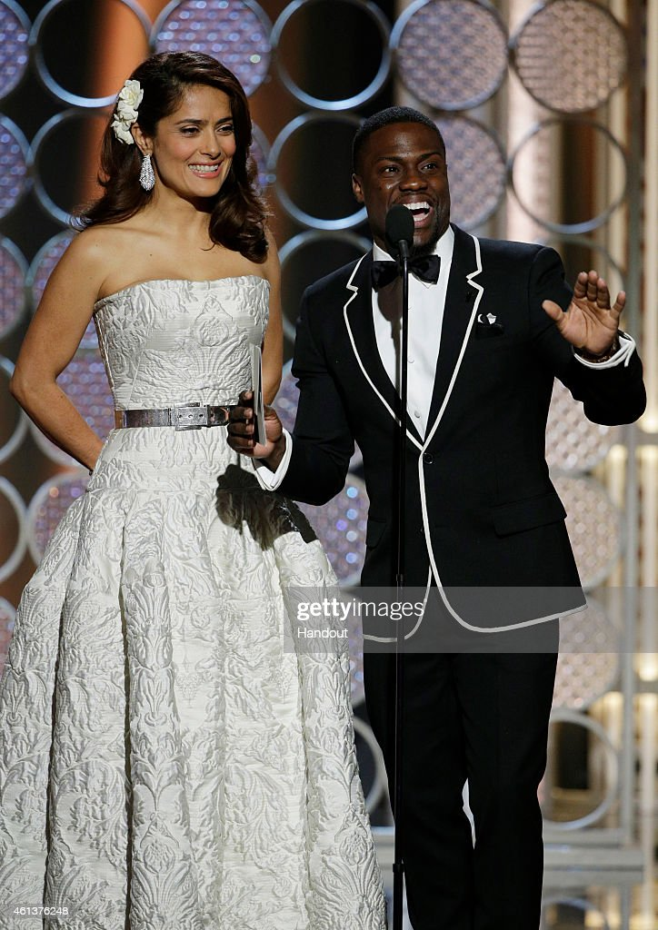 In this handout photo provided by NBCUniversal Presenters Salma Hayek and Kevin Hart speaks onstage during the 72nd Annual Golden Globe Awards at The...