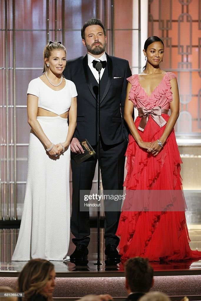 In this handout photo provided by NBCUniversal, (L-R) presenters Sienna Miller, Ben Affleck and Zoe Saldana onstage during the 74th Annual Golden Globe Awards at The Beverly Hilton Hotel on January 8, 2017 in Beverly Hills, California.