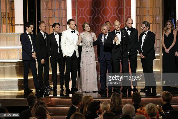 In this handout photo provided by NBCUniversal producer Fred Berger and the cast and crew of 'La La Land' accept the award for Best Motion Picture...