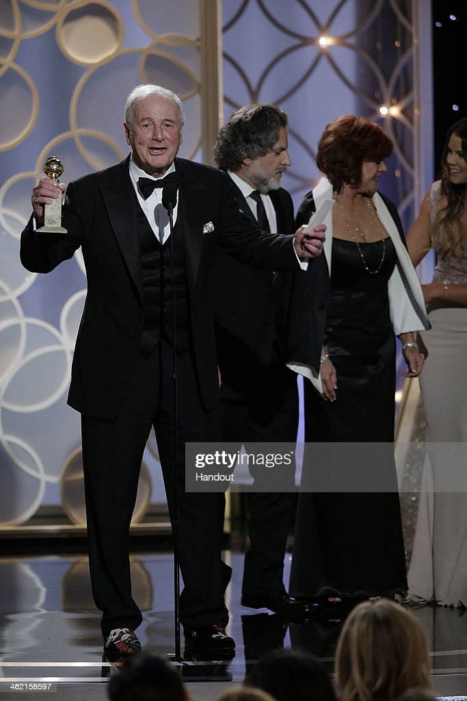 In this handout photo provided by NBCUniversal Producer Jerry Weintraub accepts the award for Best TV Movie or MiniSeries for 'Behind the Candelabra'...