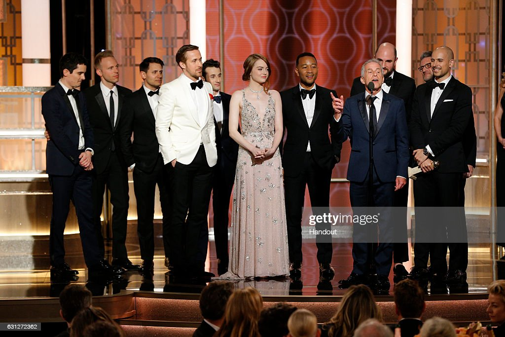 In this handout photo provided by NBCUniversal, producer Marc Platt and the cast and crew of 'La La Land' accept the award for Best Motion Picture - Musical or Comedy for 'La La Land' onstage during the 74th Annual Golden Globe Awards at The Beverly Hilton Hotel on January 8, 2017 in Beverly Hills, California.