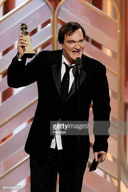 In this handout photo provided by NBCUniversal Quentin Tarantino accepts the award for Best Original Score Motion Picture for 'The Hateful Eight'...