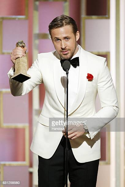 In this handout photo provided by NBCUniversal Ryan Gosling accepts the award for Best Actor in a Motion Picture Musical or Comedy for his role in...
