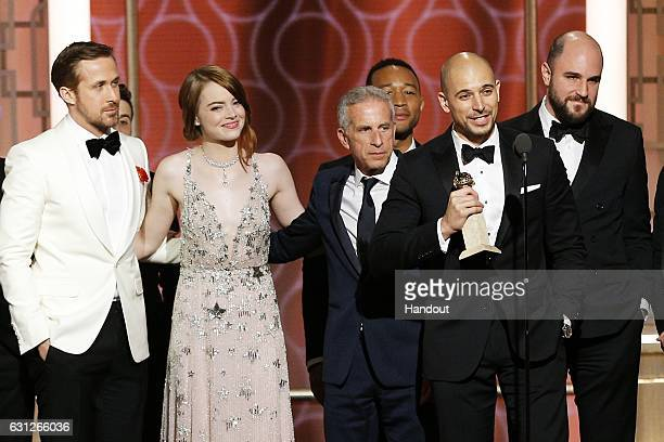 In this handout photo provided by NBCUniversal Ryan Gosling Emma Stone Marc Platt John Legend Fred Berger and Jordan Horowitz accept the award for...