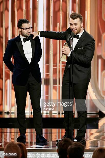 In this handout photo provided by NBCUniversal Sam Smith accepts the award for Best Original Song Motion Picture for 'Writing's on the Wall' during...