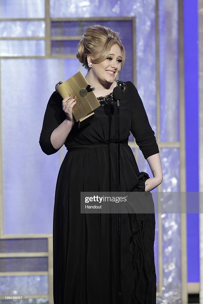 In this handout photo provided by NBCUniversal, Singer <a gi-track='captionPersonalityLinkClicked' href=/galleries/search?phrase=Adele+-+Singer&family=editorial&specificpeople=4898935 ng-click='$event.stopPropagation()'>Adele</a> accepts the Best Original Song award for Motion Picture, 'Skyfall' on stage during the 70th Annual Golden Globe Awards at the Beverly Hilton Hotel International Ballroom on January 13, 2013 in Beverly Hills, California.