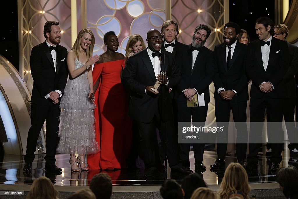 In this handout photo provided by NBCUniversal, Steve McQueen and cast accept the award for Best Motion Picture, Drama for '12 Years a Slave' during the 71st Annual Golden Globe Award at The Beverly Hilton Hotel on January 12, 2014 in Beverly Hills, California.