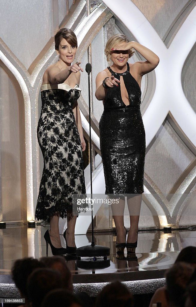 In this handout photo provided by NBCUniversal Tina Fey and Amy Poehler host the 70th Annual Golden Globe Awards at the Beverly Hilton Hotel...
