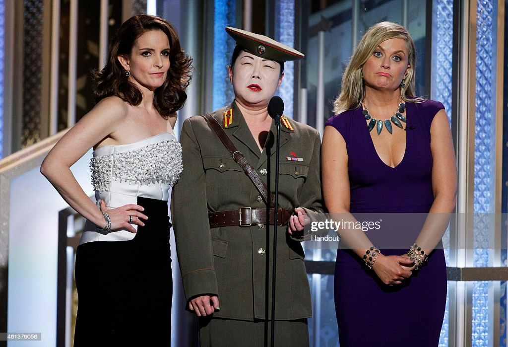 In this handout photo provided by NBCUniversal Tina Fey Margaret Cho and Amy Poehler speak onstage during the 72nd Annual Golden Globe Awards at The...