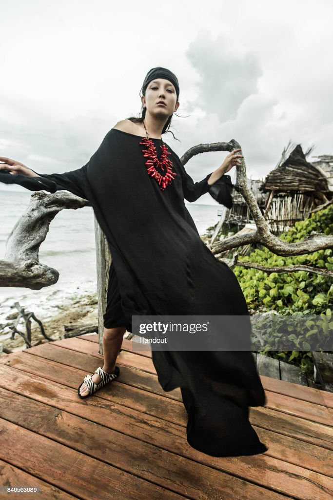 In this handout photo provided by Nicholas K, a model displays designs from Nicholas K Spring/Summer 2018 collection ahead of New York Fashion Week at Azulik August 2017 in Tulum, Mexico.
