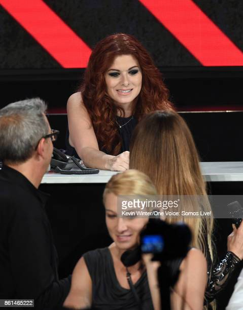 In this handout photo provided by One Voice Somos Live actor Debra Messing participates in the phone bank onstage during 'One Voice Somos Live A...