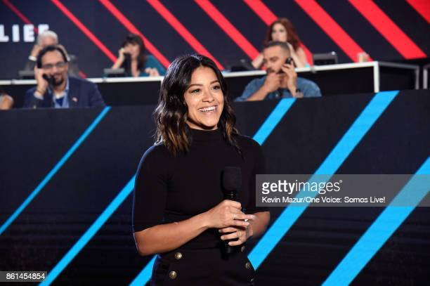 In this handout photo provided by One Voice Somos Live actor Gina Rodriguez speaks onstage during 'One Voice Somos Live A Concert For Disaster...