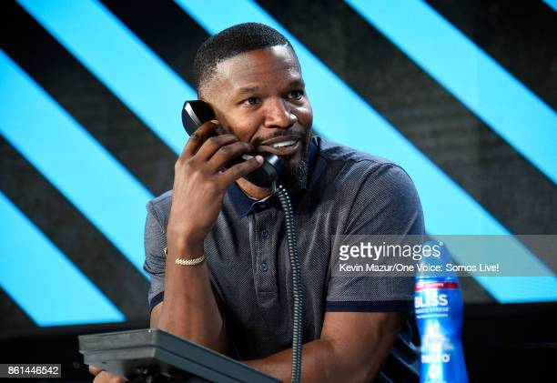 In this handout photo provided by One Voice Somos Live actor Jamie Foxx participates in the phone bank onstage during 'One Voice Somos Live A Concert...