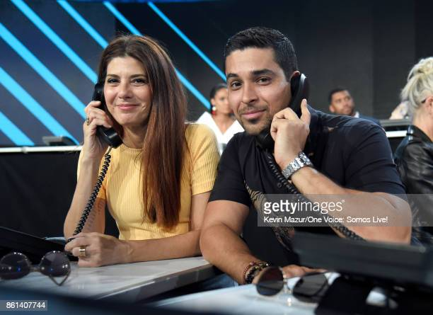 In this handout photo provided by One Voice Somos Live actors Marisa Tomei and Wilmer Valderrama participate in the phone bank onstage during 'One...