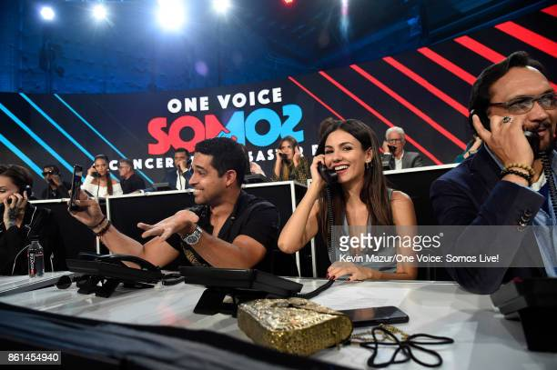 In this handout photo provided by One Voice Somos Live actors Wilmer Valderrama and Victoria Justice participate in the phone bank onstage during...