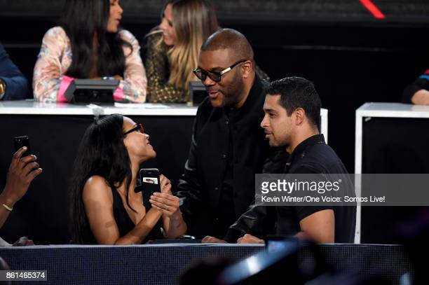 In this handout photo provided by One Voice Somos Live actors Zoe Saldana Tyler Perry and Wilmer Valderrama participate in the phone bank onstage...