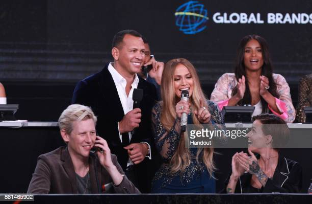 In this handout photo provided by One Voice Somos Live Alex Rodriguez and Jennifer Lopez participate in the phone bank during 'One Voice Somos Live A...