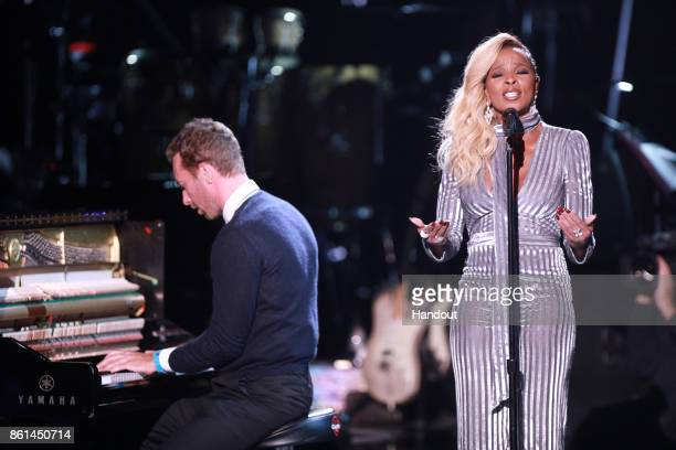 In this handout photo provided by One Voice Somos Live Chris Martin and Mary J Blige perform onstage during 'One Voice Somos Live A Concert For...
