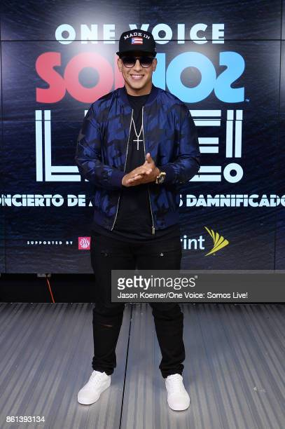In this handout photo provided by One Voice Somos Live Daddy Yankee poses in the pressroom at One Voice Somos Live A Concert For Disaster Relief at...