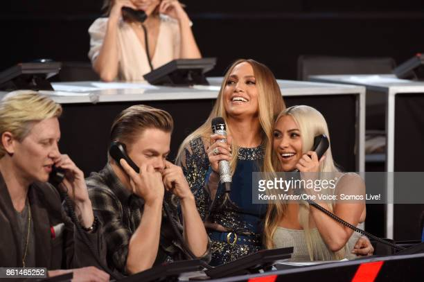 In this handout photo provided by One Voice Somos Live Dancer Derek Hough Jennifer Lopez and Kim Kardashian participate in the phone bank onstage...