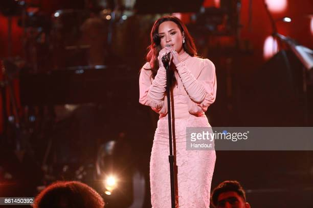 In this handout photo provided by One Voice Somos Live Demi Lovato performs onstage during 'One Voice Somos Live A Concert For Disaster Relief' at...