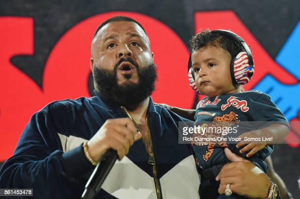 In this handout photo provided by One Voice Somos Live DJ Khaled speaks onstage with son Asahd Tuck Khaled at One Voice Somos Live A Concert For...